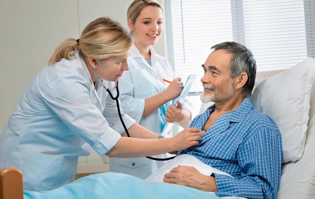 doctors checking senior man's health
