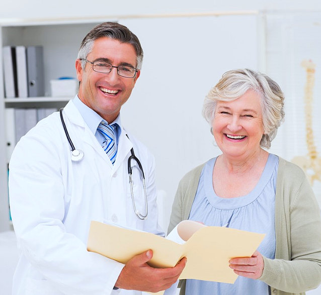 doctor and senior woman smiling